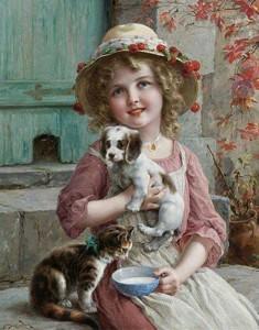 Çocuk ve hayvan sevgisi... Sevimli kızcağız kedi ve köpeği ile birlikte...
